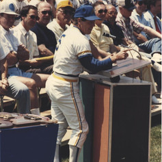 Coach speaking to the crowd at the 1988 parade ceremonies.