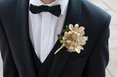 Gold Orchid boutonniere