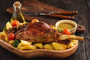 Slow baked lamb leg with potatoes and sa