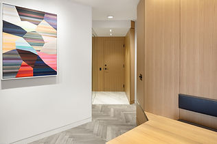Pied-à-terre Yorkville condo renovation with white oak wall