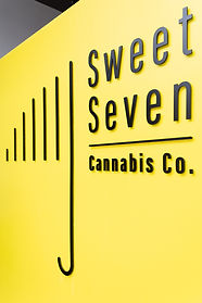 Sweet Seven Cannabis Co. store at yellow entrance signage
