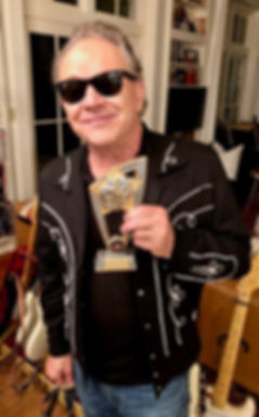 jimmie vaughan with award.jpeg