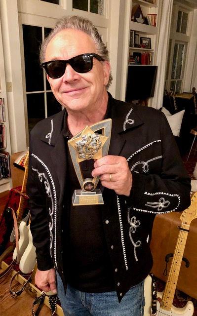 jimmie vaughan with award.jpeg