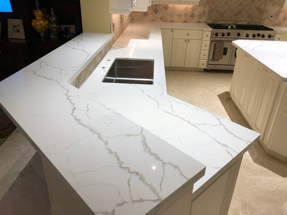Calacatta Laza quartz countertops installer in Boca Raton FL feel free to contact us 33432