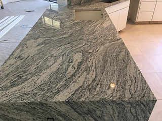 Granite Kitchen Countertops with waterfall countertop edge