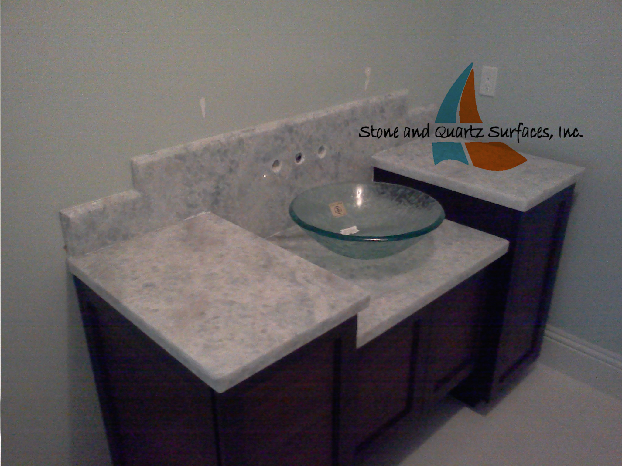 quartzite vanity top with a vessel