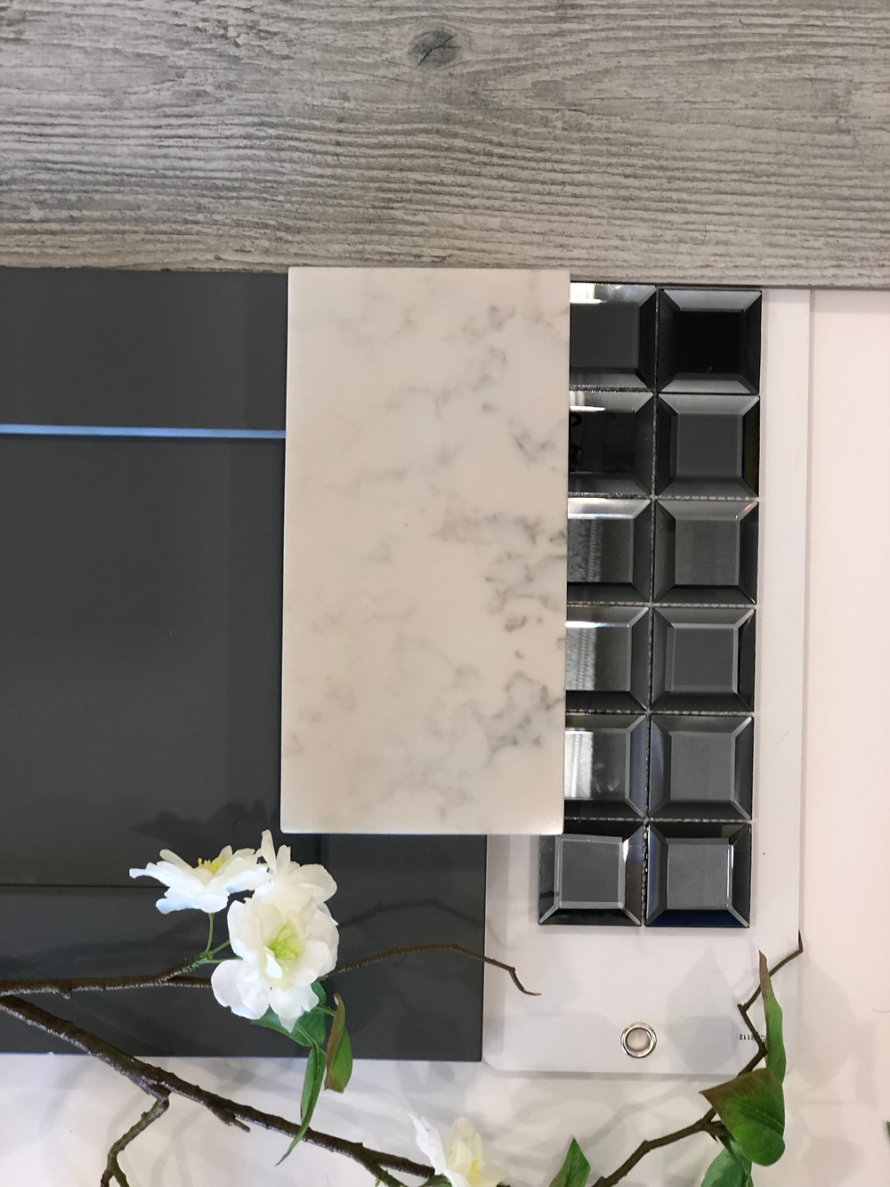 If you looking for grey color to define your kitchen, here is a good option to be installed with Carrara Grigio Quartz Countertops, Porcelain earth grey tile floor, back splash tile Hematite Squares, shaker grey kitchen cabinets.