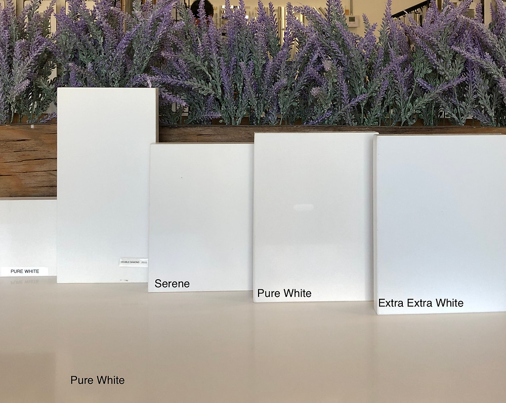 White quartz countertops options and Tones. Different tones of Pure White countertops Contact Stone and Quartz LLC Boca Raton FL