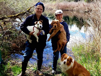 the pond beyond with dogs.PNG