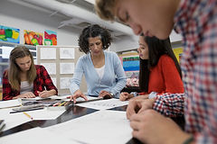 high school classroom teacher and students