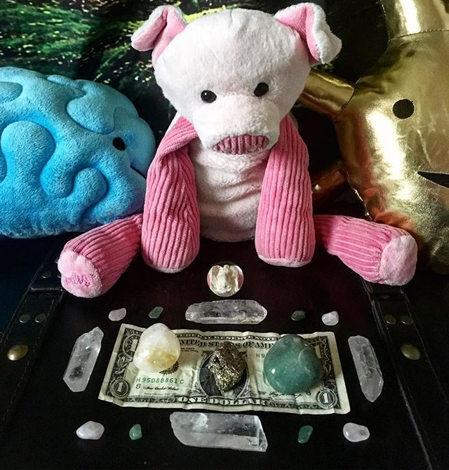 Meditation brain, penny the proxy pig and the heart of gold are keeping an eye on my Reiki charged m