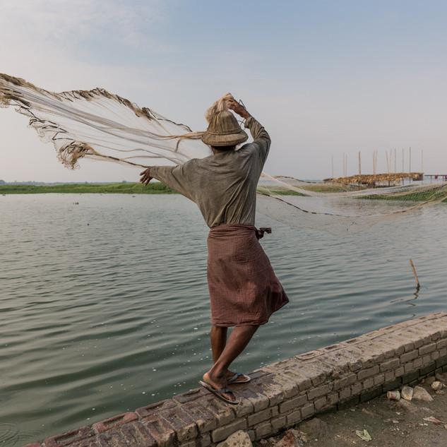Net fishing by U Bein bridge