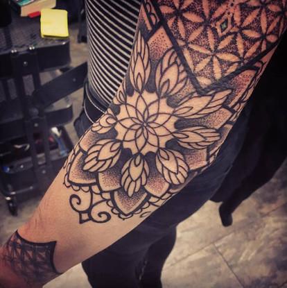 mandala blackwork pattern tattoo