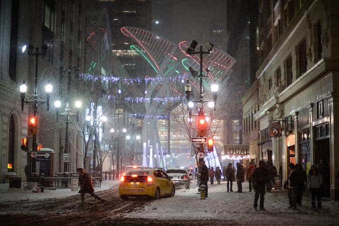 Calgary city view, winter, snowfall, snow, Stephens Avenue, 8th avenue, city centre, downtown, new year, celebration, christmas, snowfall, heavy snow, walking people, crowd, Local Pub, bar, night, cab, taxi.jpg
