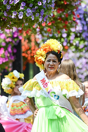 Calgary, Alberta, Canada, mexican woman, mexican girl, flowers, heritage festival, street, summer.jpg