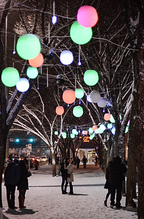 Calgary city view, winter, snowfall, snow, olympic plaza, downtown, new year, celebration, christmas, kissing couple, couples.jpg