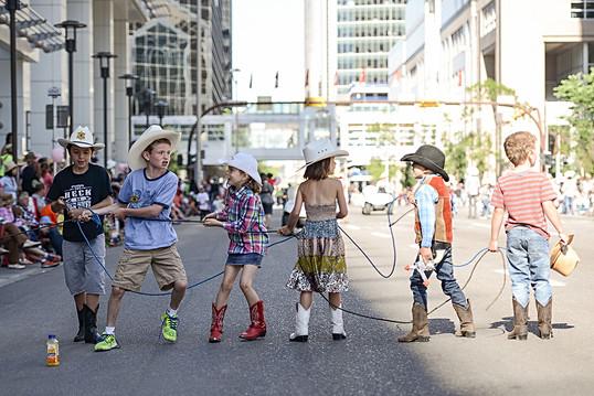 Calgary Stampede. Alberta, Canada, summer, AB, cowboy, cowgirl, boots, rope, kids, downtown, Stampede Parade, hat, gun, crowd.jpeg