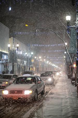 Calgary city view, winter, snowfall, snow, Calgary Palace, Stephens Avenue, 8th avenue, city centre, downtown, new year, celebration, christmas, a cab, taxi, road, cars, vehicles, heavy snow.jpg