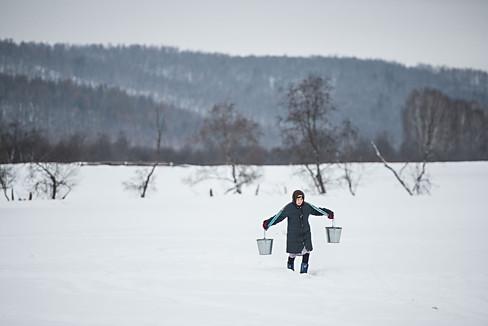 Ural, Russia, country side, winter, snow, woman, yoke, bucket, spring water, tree.jpg