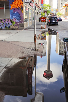 Calgary, Alberta, Tower, Canada, puddle, water, reflection, sky, road, street, graffity, car..jpg