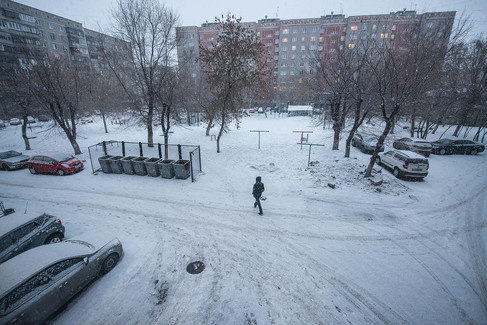 Magnitogorsk, Russia, chelyabinsk, city, view from a window, a person walks, winter, snow, yard, parked cars, 9 floor building.jpg