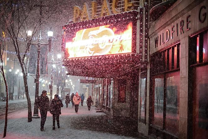 Calgary city view, winter, snowfall, snow, Calgary Palace, Stephens Avenue, 8th avenue, city centre, downtown, new year, celebration, christmas, a couple, snowfall, heavy snow, walking people.jpg