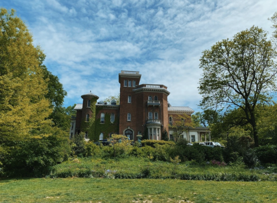 The exterior of Litchfield Villa, surrounded by trees and grass, in Prospect Park, Brooklyn.