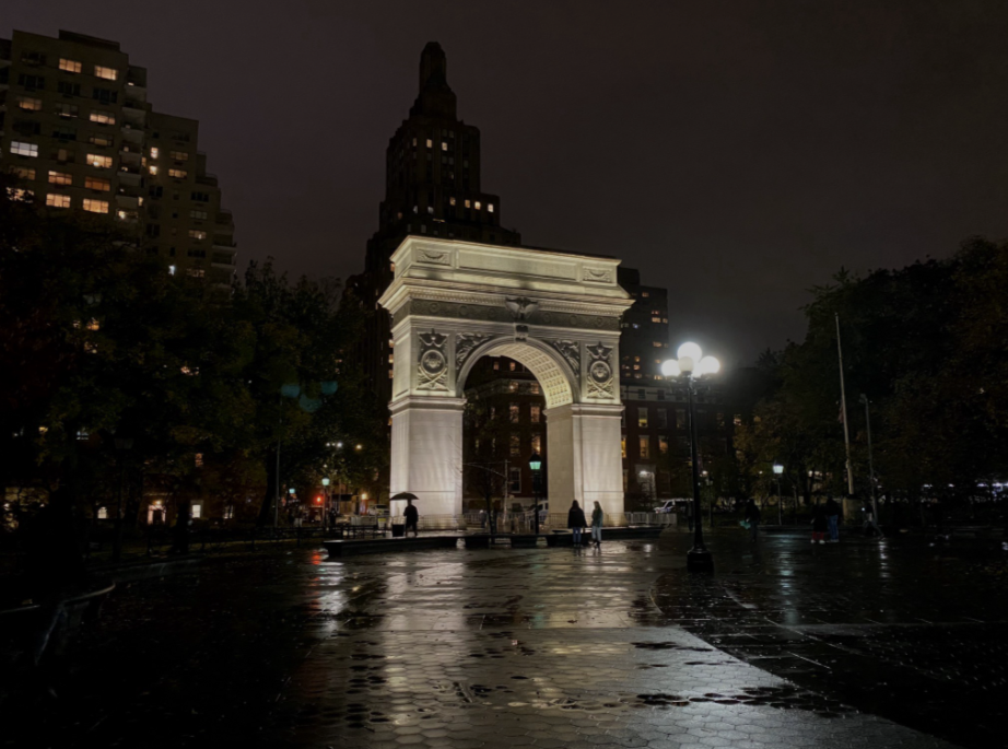 The Washington Square Arch lit up at night. Located in Washington Square Park in Greenwich Village, New York.