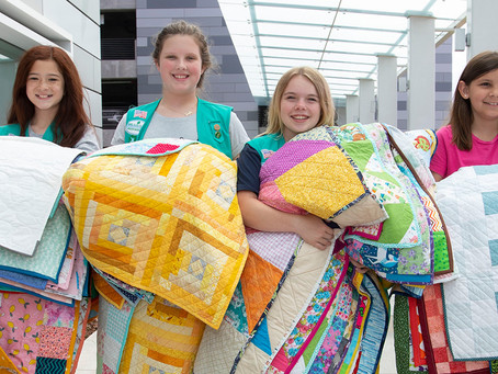 Girl Scouts sew up Bronze Awards with NICU quilting project