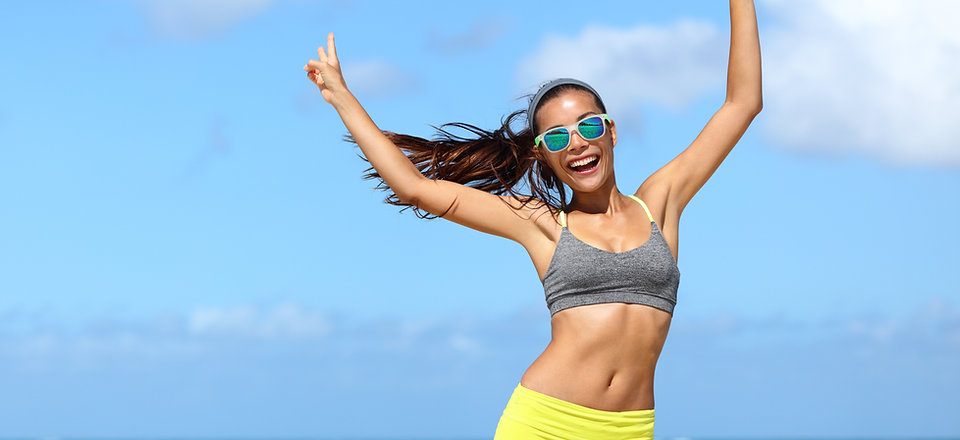 Happy cheerful fitness woman in sunglass