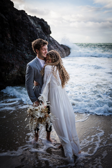 Bridal couple hugging in the sea