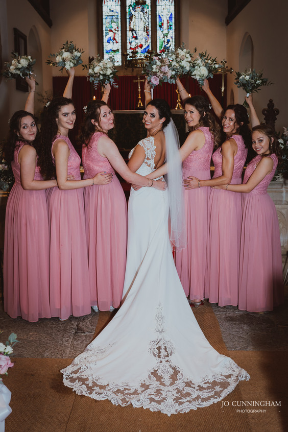 Bridesmaids and bride in the church