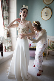 Mother of the bride and bride laughing