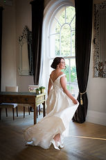 Dancing bride in the ceremony room at Exeter Castle