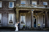 The married couple in front of Buckland House, a stunning venue