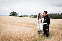 The married couple photographed in the cornfields of The Oak Barn not far from Crediton, Devon