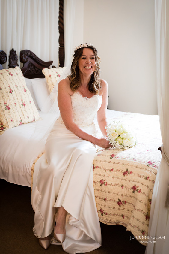 Bride on four poster bed