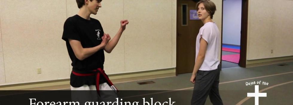 Forearm guarding block