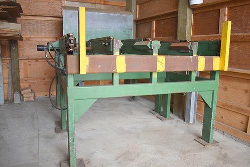 Tilt hoist with 5 strand infeed chain deck
