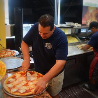 Alex Cutting Pizza