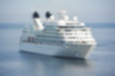 white-cruise-ship-on-blue-body-of-water-