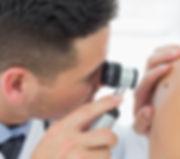 shutterstock_doctor mole examination.jpg