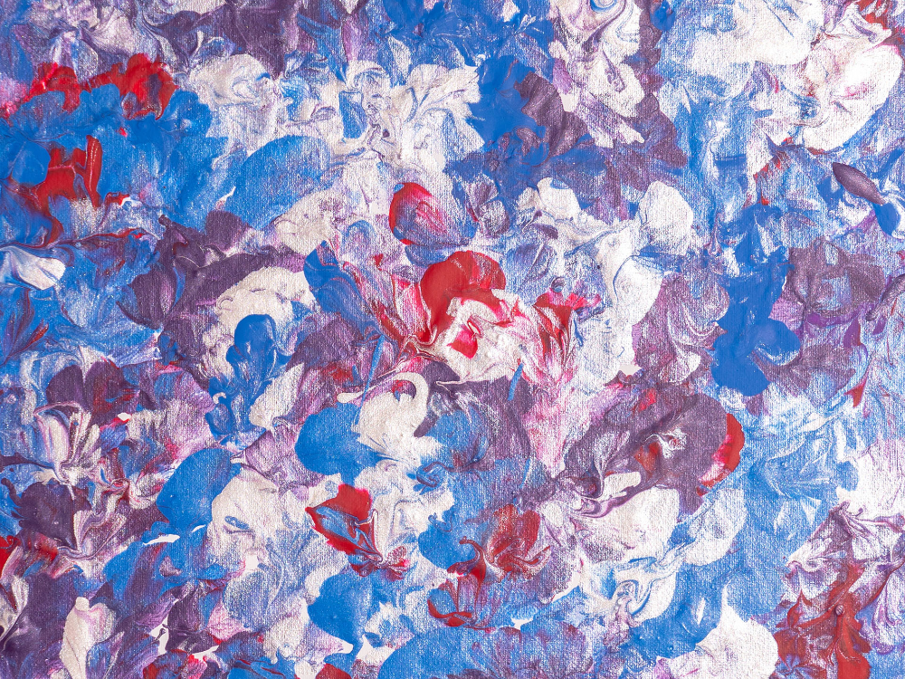 An abstract painting with blue, red, white, and purple brush marks blended together