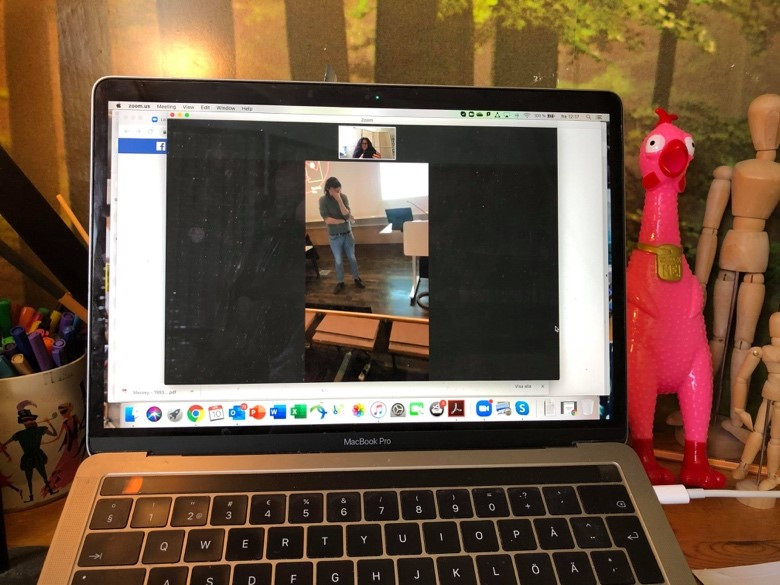 A picture of a video call on a laptop screen, with the person in the call putting his face in his hand.