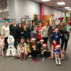 Mary Lorraine's Dance Center Family decorating the dance studio for christmas