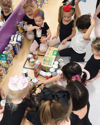 Kids at Mary Lorraine's Dance Center Counting cans to be donated