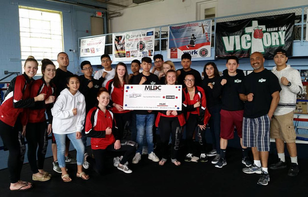 presenting a donation to the Victory boxing club