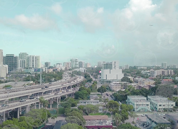 Miami Traffic with Buildings and a Plane Flying