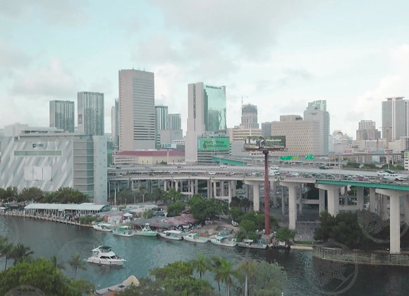 Downtown Miami River with a Boat Floating By