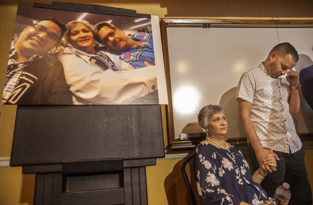 Paola French and son Kevin attend a Monday news conference on the June 14 scuffle in Corona. Kenneth French, 32, was killed.